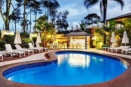 Coffs Harbour: From $399 for Apartment Stay for Four with Bottle of Wine and Late Checkout at Smugglers on the Beach